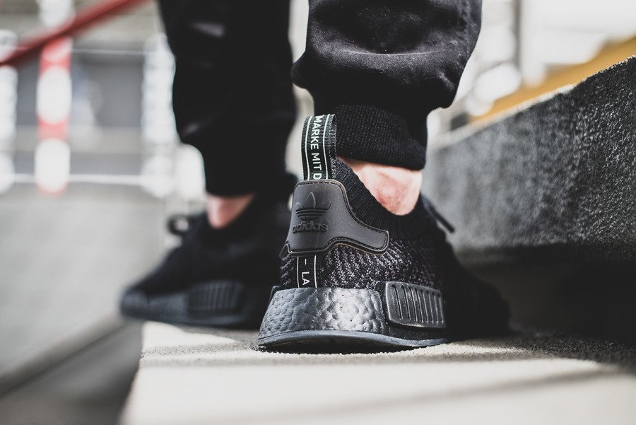 9ce8f0bee2016 ... Triple Black  On Feet Shots Of Mens Shoes sneakers adidas Originals NMD  R1 STLT Primeknit CQ2391 ...